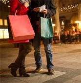 Man and woman holding shopping bags