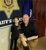 Sheriff Kevin Tolson with Mia Kramer.