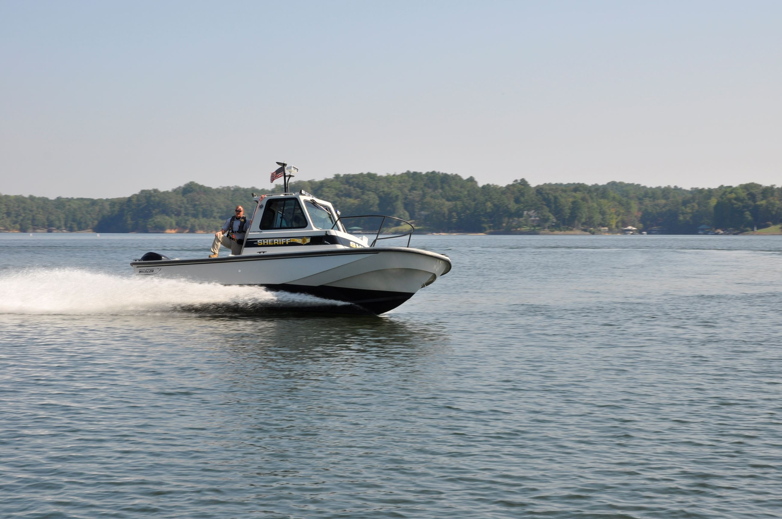 The Lake Enforcement Unit boat at high speed patrolling Lake Wylie