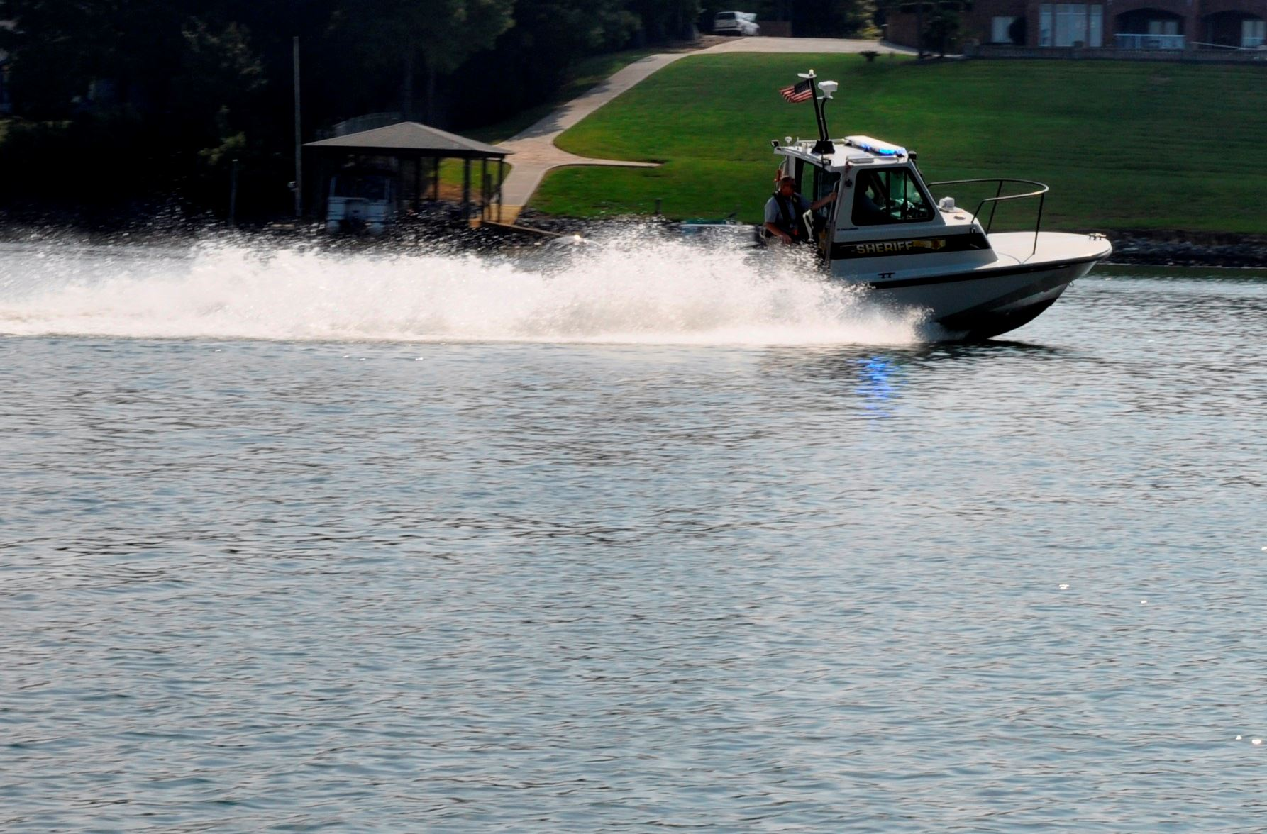 The Lake Enforcement Unit boat on Lake Wylie making a turn