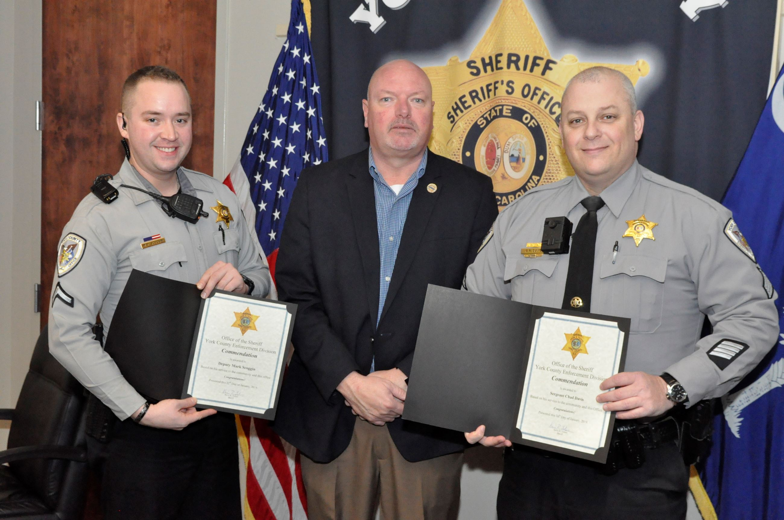 Photo of Sgt. Chad Davis, Sheriff Tolson and Dep. Oliver
